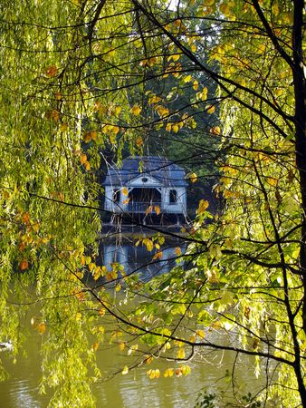 boathouse: boathouse framed by autumnal foliage