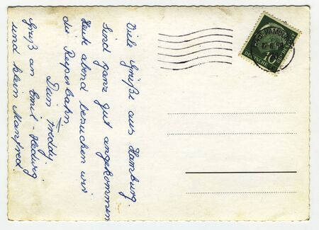 Back of grungy vintage postcard from Hamburg with blank addressfield