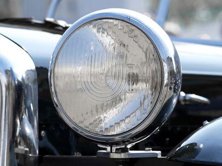 headlamp: Detail of Headlamp of vintage black automobile