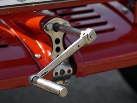 detail: starter crank of vintage red automobile