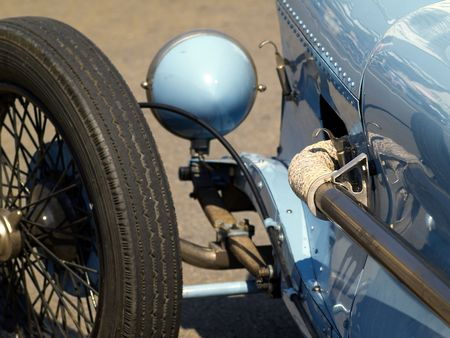 detail of vintage blue sports car, suspension