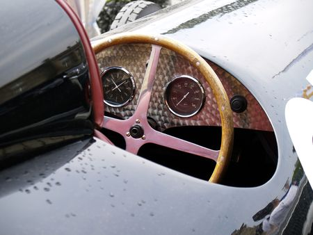 detail of vintage racing cars cockpit, raindrops