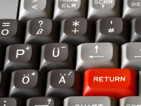Red returnenter-key on computer keyboard photo