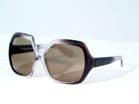 fashionable sunglasses: 1970s style fashionable sunglasses over white