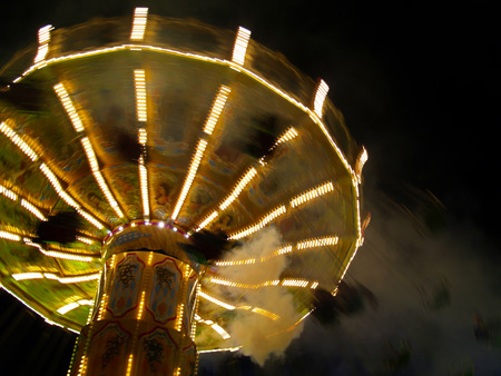 chairoplane: Chairloplane at the carnival, evening, motion blur Stock Photo