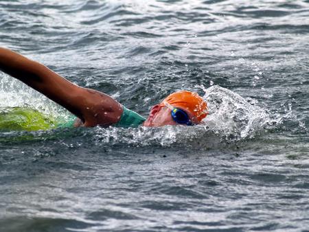 male tri-athlete on swim-stroke Stock Photo
