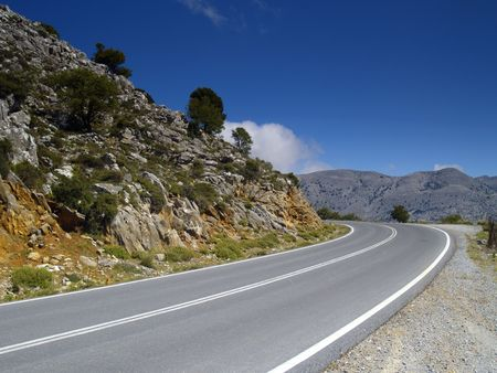road in cretan mountains on a bright sunny day Stock Photo