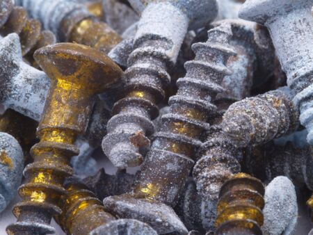 corroded: old corroded brass screws for use as a background