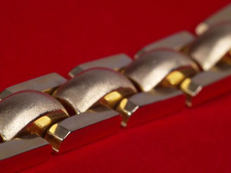 wristband: photo of gold wristband on red velvet