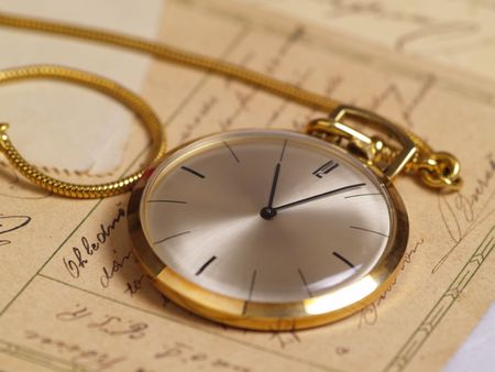 watch over: pocket watch over old postcards  Stock Photo