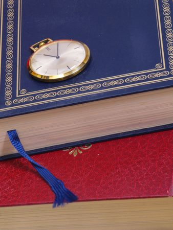 watch over: pocket watch over old books