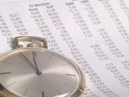 watch over: pocket watch over stock chart numbers Stock Photo