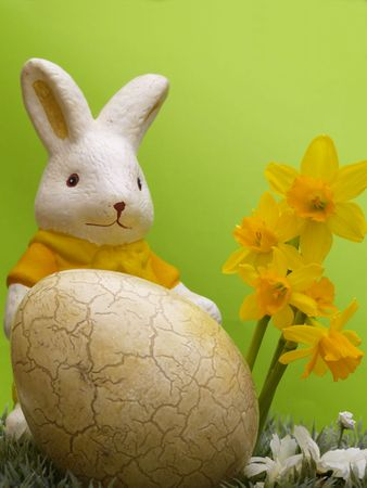 easter egg and bunny with dwarf daffodils on artificial grass and blossoms, green background Stock Photo - 4433989