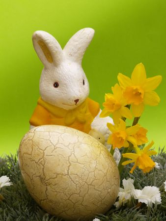 easter egg and bunny with dwarf daffodils on artificial grass and blossoms, green background Stock Photo - 4433998