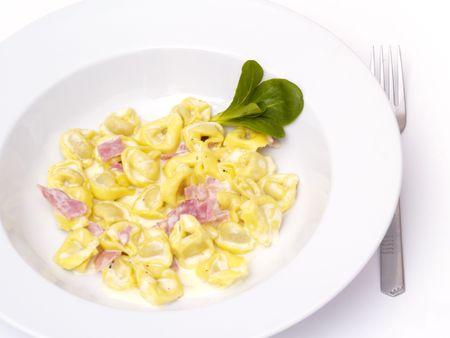 Tortellini panna on white plate