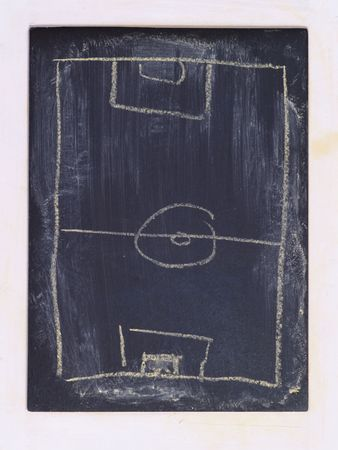 sketch of football field on grungy chalkboard framed by white painted wood Stock Photo
