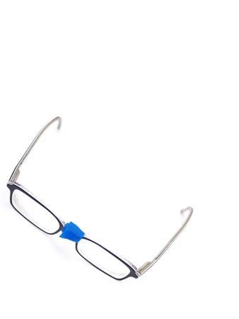 repaired: broken eyeglasses provisorily repaired with blue tape Stock Photo