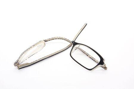broken eyeglasses on white photo