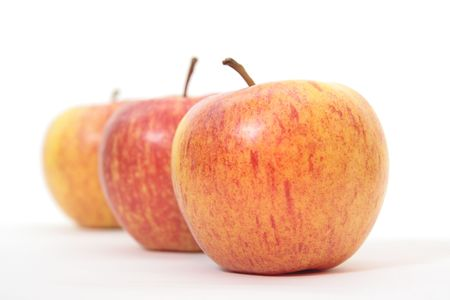 three red and yellow apples on white Stock Photo - 4906185