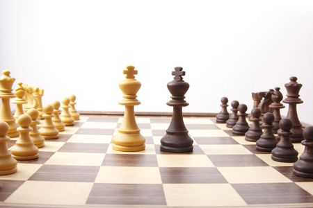 chessmen on chess board, kings meeting in the middle to find a diplomatic solution Stock Photo