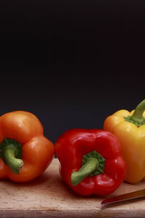 sweet peppers: bell peppers on chopping board Stock Photo
