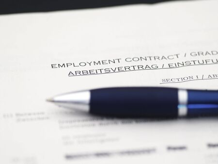 bilingual: detail of bilingual employment contract, english - german