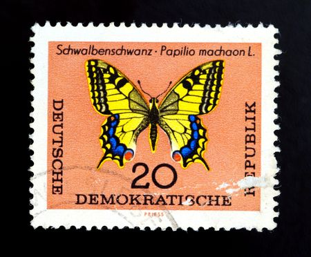 german democratic republic - CIRCA 1980: butterfly on old canceled postage stamp photo