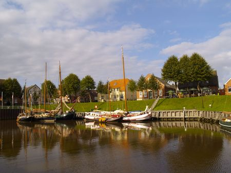 historic ships in the old harbor of carolinensiel, germany