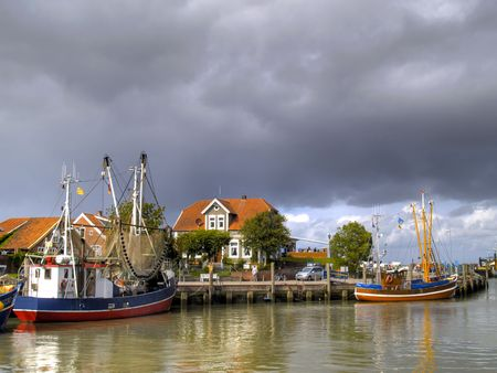 Harbor of Neuharlingersiel at the german north sea coast photo
