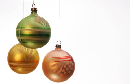 vintage pink , yellow and green christmas balls with white background photo
