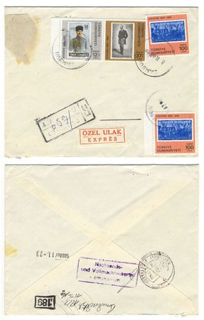 vintage grungy envelope with lots of old canceled postage stamps from turkey photo