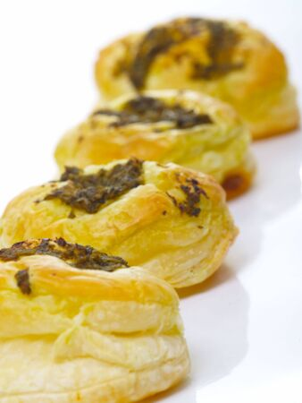 topped: homemade pesto topped pastry puffs