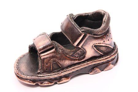 bronzed: photo of a bronzed baby shoe Stock Photo