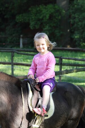little girl on horseback