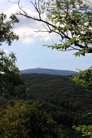 brocken: view from burgberg over forests to mount brocken, harz, lower saxony, germany