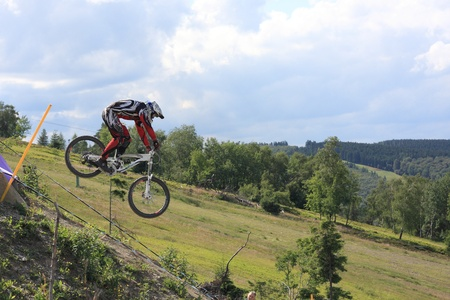 mountainbiking: WILLINGEN, GER - JUNE 17, unknown competitor , racing at downhill qualification, Willingen, Germany, June 17, 2011  Editorial