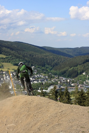 mountainbiking: WILLINGEN, GER - JUNE 17, unknown competitor , racing at downhill qualification,Willingen in the background, Willingen, Germany, June 17, 2011