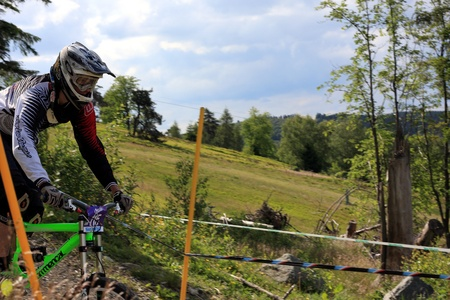 mountainbiking: WILLINGEN, GER - JUNE 17, unknown competitor #115, racing at downhill qualification, not qualifying for final race, Willingen, Germany, June 17, 2011  Editorial