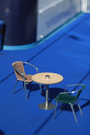 tilt: table with two chairs onboard a passenger ship, tilt lens Stock Photo