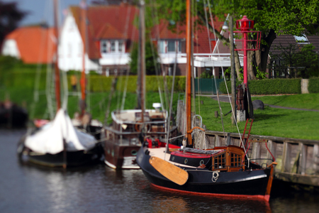 selective focus photo of a vintage sailboat in a harbor Stock Photo