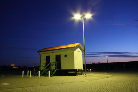 public restroom on a trailer at night