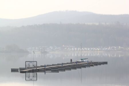 flating pier on Lake Edersee in the early mornin Stock Photo