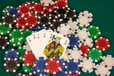 big slick: four of a kind winning hand with chips Editorial