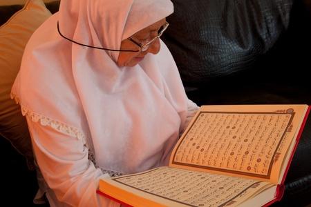 creed: Muslim women read the Holy Koran