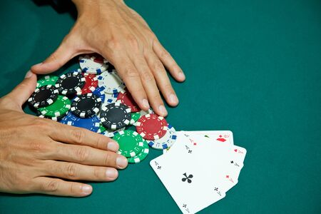 big slick: four of a kind winning hand with chips  Stock Photo