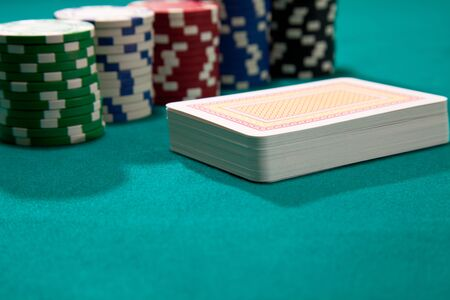 poker chips and deck of card photo