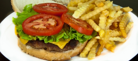 delicious hamburger with fries photo
