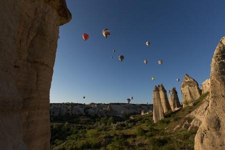 hot air balloon trip at famous cave house Cappadocia Turkey 免版税图像
