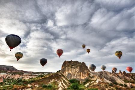 hot air balloon trip at famous cave house Cappadocia Turkey