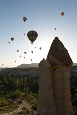 cave house: hot air balloon trip at famous cave house Cappadocia Turkey Stock Photo
